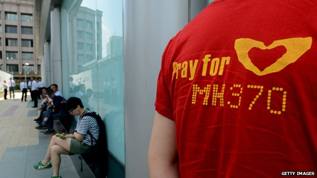 Missing flight MH370 - Page 2 _77444951_mh370-t-shirt