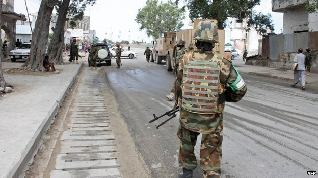 Soldiers of the African Union Mission in Somalia (Amisom) secure an area near a prison in Mogadishu on 31 August 2014
