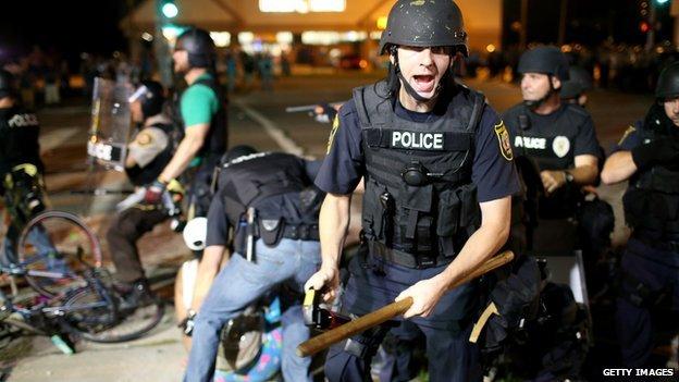 Police arrest a protestor in Ferguson, Missouri, on 18 August, 2014.