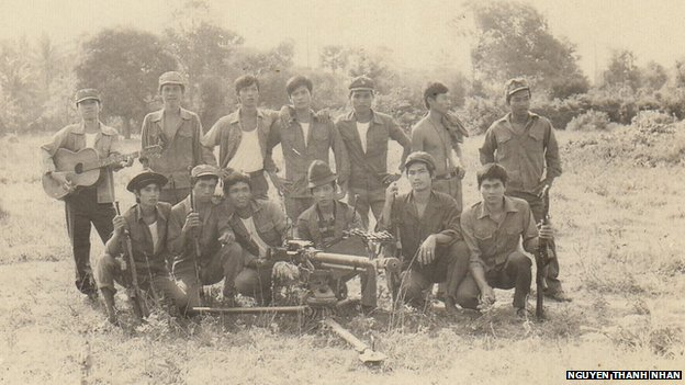 The author, Nguyen Thanh Nhan, (kneeling second from left) at a Vietnamese military base inside Cambodia, 1985