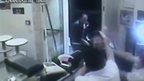 CCTV of man hitting thief with plate