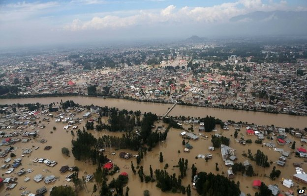 An aerial view shows buildings submerged in floodwaters in Srinagar, in Indian Kashmir, Tuesday, Sept. 9, 2014