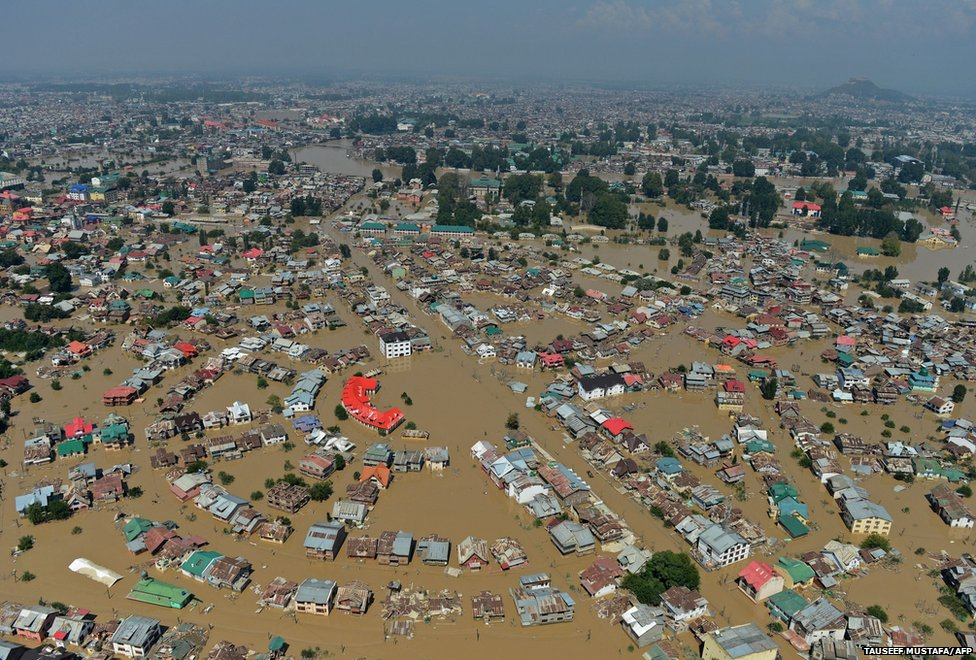 Kashmiri houseboats and houses submerged by floodwater