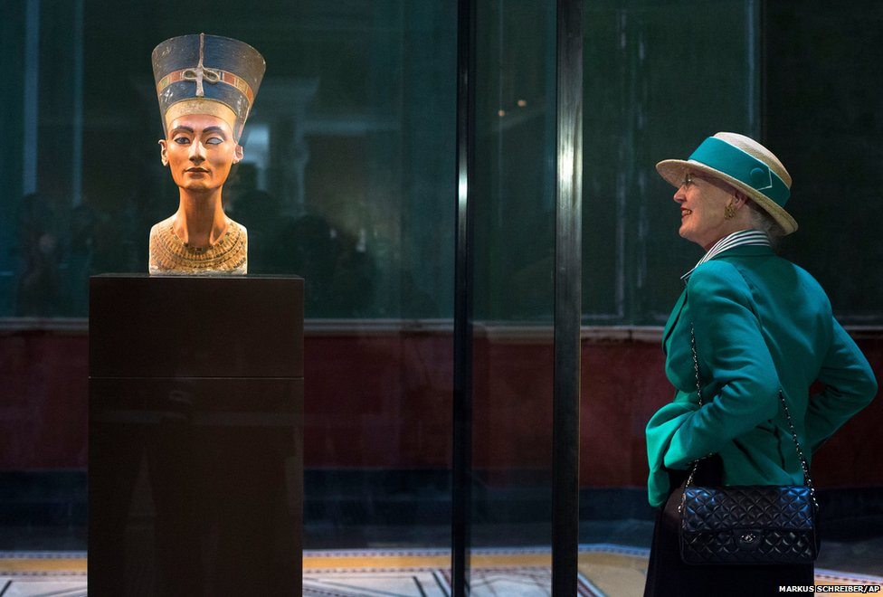 Queen Margrethe II of Denmark looks at the bust of Egyptian Nefertiti during a visit to the New Museum in Berlin, Germany