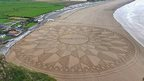 Sand art by Simon Beck at Brean Beach, Somerset