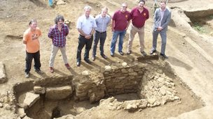 Archaeologist Jim Brown (left) and Alaric Neville (second left) with local brewery workers and the malting oven.