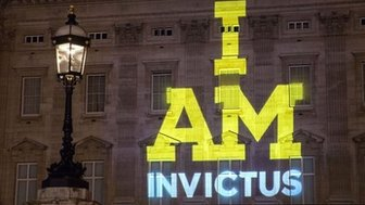 I AM INVICTUS projected onto Buckingham Palace