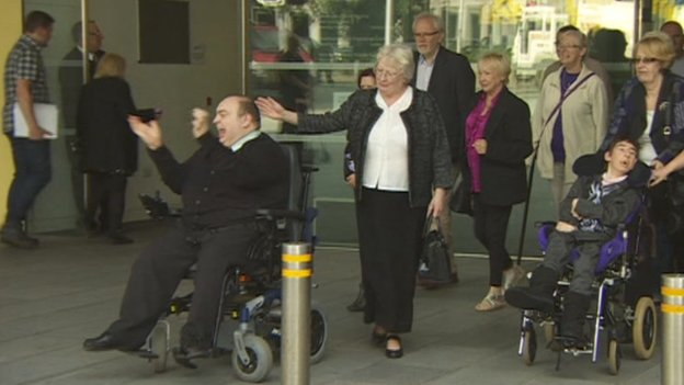 Michael Robson (pictured left in wheelchair)