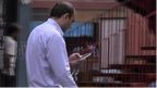 Man checking mobile phone