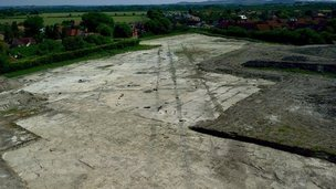 Aston Clinton excavation showing Roman road line and post holes