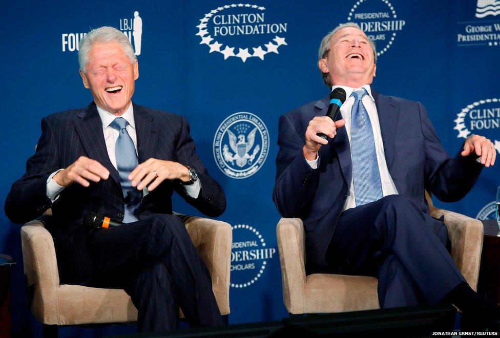 Former US presidents Bill Clinton (left) and George W Bush l