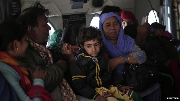 "A Kashmiri family sits inside an Indian Air Force""s (IAF) helicopter after being rescued from a flooded area in Srinagar September 11, 2014."