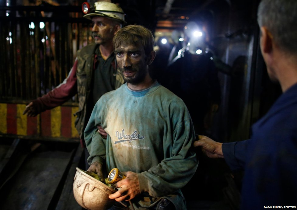 A trapped coal miner leaves the Raspotocje mine