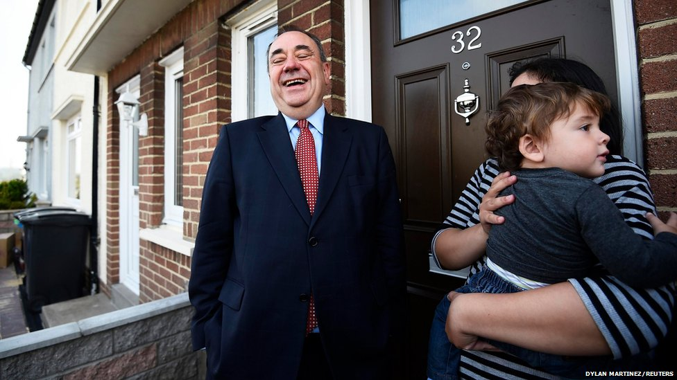 Scotland's First Minister Alex Salmond meets Shirley McGettiga and her son Kyle during canvassing in Dyce, Aberdeen