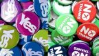 Badges saying Yes and No