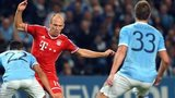 Arjen Robben takes on Gael Clichy