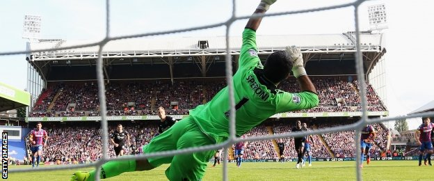 Julian Speroni saves a penalty against Burnley