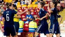 Jane Ross (right) is hailed after making it 3-0 Scotland