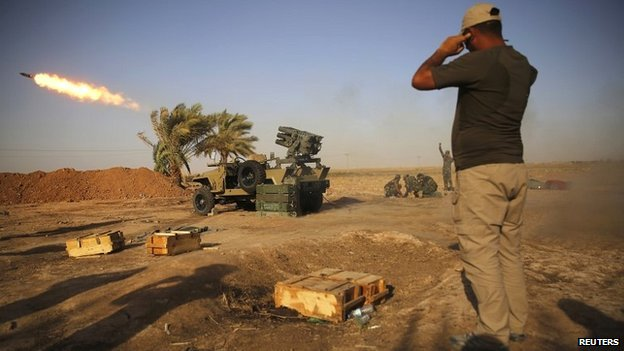 Members of a Shia militia launch rockets towards Islamic State fighters during heavy fighting near Tikrit in northern Iraq - 12 September 2014