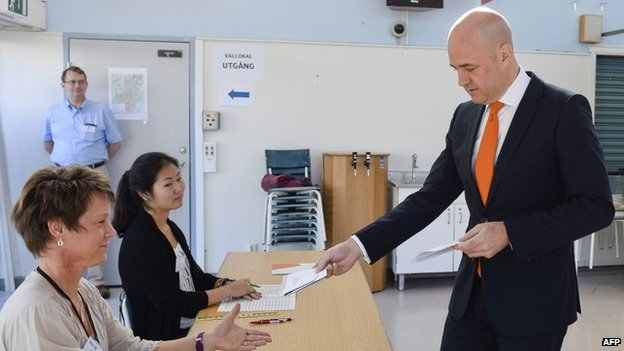 Sweden's Prime Minister and leader of the Moderate Party, Fredrik Reinfeldt casts his ballot at a polling station in the Stockholm suburb of Taeby.