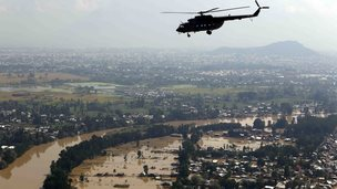 In this photograph released by the Indian Air Force, a chopper flies over flood-affected Srinagar in Indian-controlled Kashmir