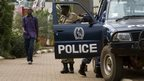 Ugandan police stand guard outside a popular shopping mall in the capital Kampala - 14 September 2014