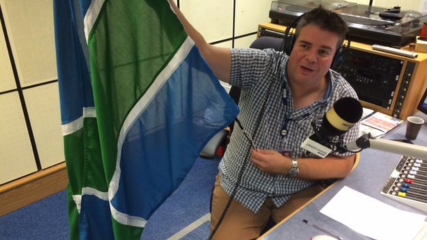 Ian Skye with BBC Radio Derby's Derbyshire flag