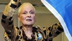 Vivienne Westwood poses with the Saltire flag of Scotland