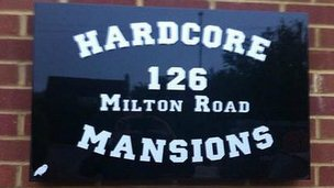 Hardcore Mansions sign