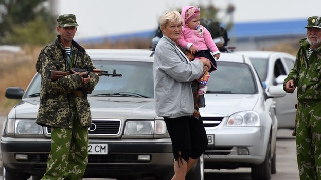 Ukrainian woman, child and rebels at Russian border, file pic