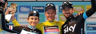 Dylan van Baarle flanked by Michal Kwiatkowski and Bradley Wiggins