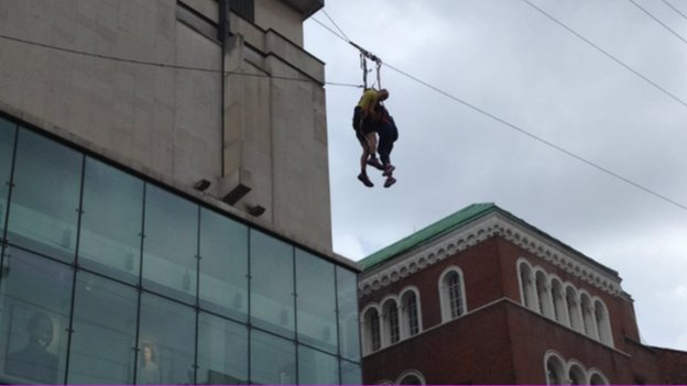 Woman stuck on zip wire