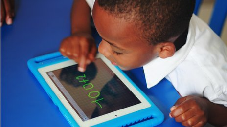 A child doing sums on the Qelasy tablet
