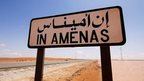 "A road sign which says: ""In Amenas"""