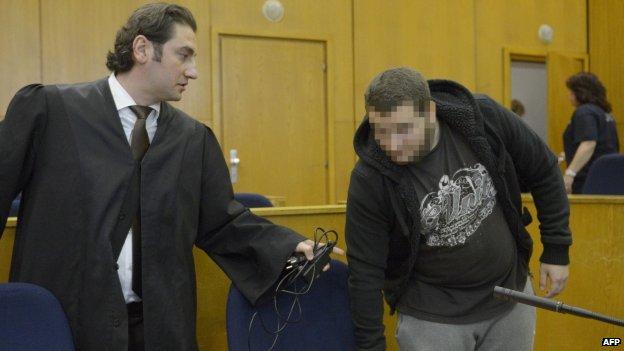 Kreshnik Berisha (left) and his defence lawyer in court. Photo: 15 September 2014