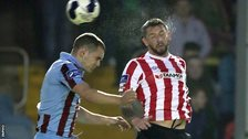 Drogheda's Mick Daly and City striker Rory Patterson battle for the high ball during Friday night's draw