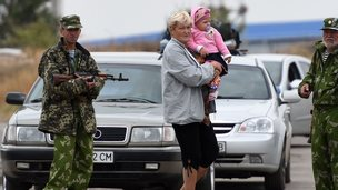 Ukrainian woman, child and rebels at Russian border, file pic