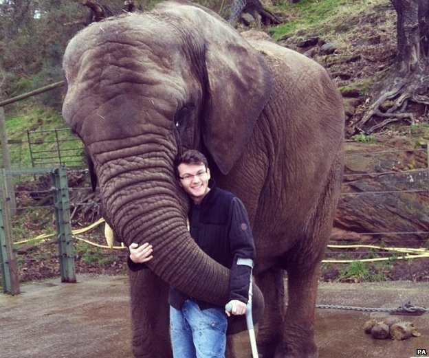 Stephen Sutton hugs an elephant
