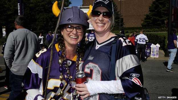 A Minnesota Vikings fan carries a stick before their game on Sunday.