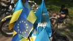 A Ukrainian flag mixed with an EU flag at a vendor's stall in Lviv, western Ukraine