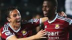 Enner Valencia celebrates his goal with West Ham team-mate Stewart Downing