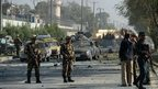 Afghan security forces keep watch at the site of a suicide attack in Kabul on 16 September 2014