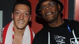 Mesut Ozil (left) with Samuel L Jackson