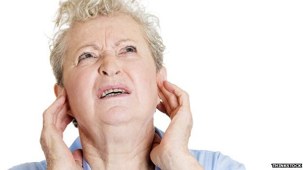 Woman holding ears