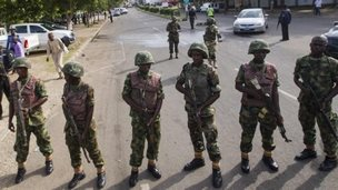 File photo: Nigerian soldiers cordon off a road leading to the scene of a blast at a business district in Abuja  (June 2014)