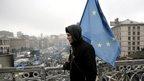 Man walks in Kiev with EU flag (1 March)