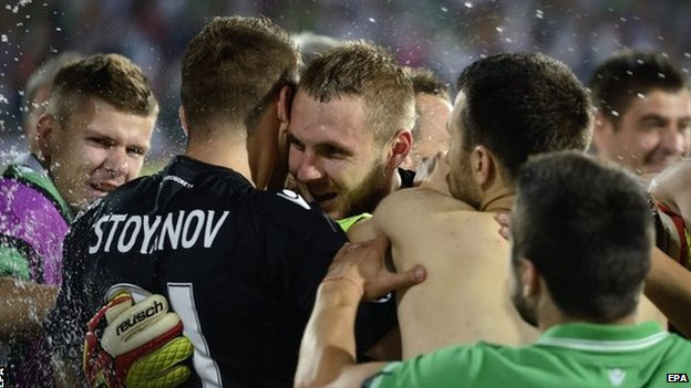 Cosmin Moti is congratulated by his team-mates