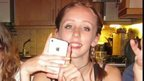 Alice Gross with her white iPhone 4 s