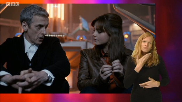 A still from an episode of Doctor Who including an in-vision signer in the bottom right-hand corner