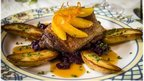 Duck confit, a classic French entree, at Le Vieux Logis restaurant